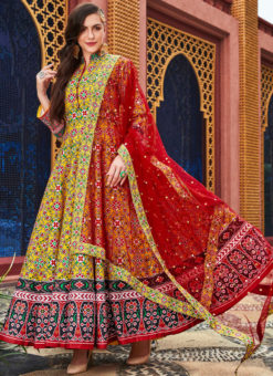 Excellent Yellow Silk Patola Printed Work Gown Suit