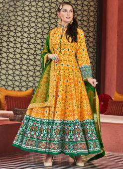 Graceful Yellow Silk Patola Printed Work Gown Suit